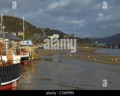 Fishing boats at low tide Barmouth Gwynedd Wales UK United Kingdom GB Great Britain - Stock Photo