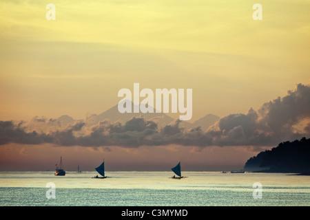 Indonesia, Island Bali, near Tejakula village, Gaia Oasis Resort. Sunrise. Fishermen. - Stock Photo