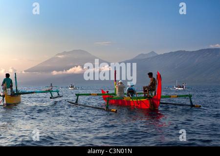 Indonesia, Island Bali, near Tejakula village, Gaia Oasis Resort. Tourists taking a tour with fishmen. - Stock Photo