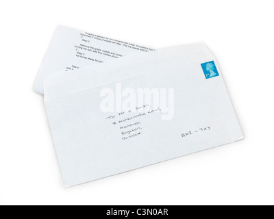 A Letter In An Envelope With A Stamp - Stock Photo
