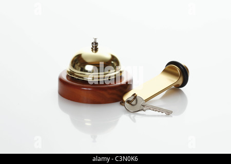 Hotel key and service bell on white background - Stock Photo