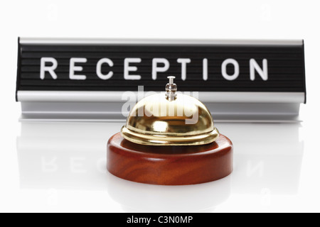 Reception sign with service bell on white background - Stock Photo