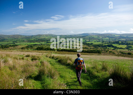 Walker in the Owenkillew Valley on the Robbers Table walk. Sperrin Mountains, County Tyrone, Northern Ireland. - Stock Photo