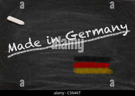 High resolution image with chalk lettering Made in Germnay and painted German national flag on black chalkboard. - Stock Photo