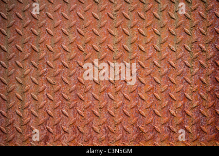 Photography shows a rusty metall background with diamond pattern. - Stock Photo