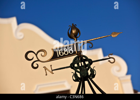 South Africa, Western Cape, Franschhoek, Wind vane in front of Cape Dutch house. - Stock Photo