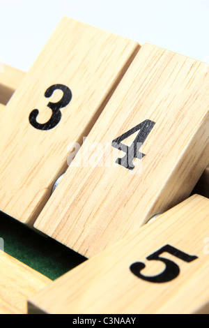 Numbers 3, 4 and 5 on a board game - Stock Photo