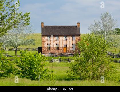 The old stone house in the center of the Manassas Civil War battlefield site near Bull Run, Virginia, USA - Stock Photo