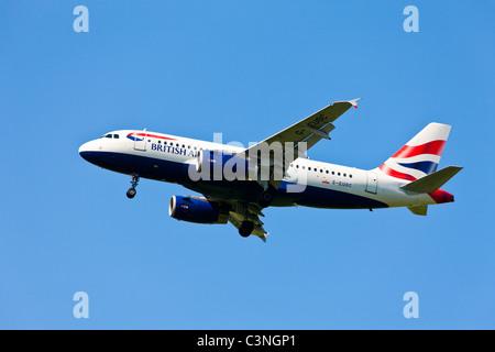 Flight British Airways ( Airbus A319 ) landing - Stock Photo