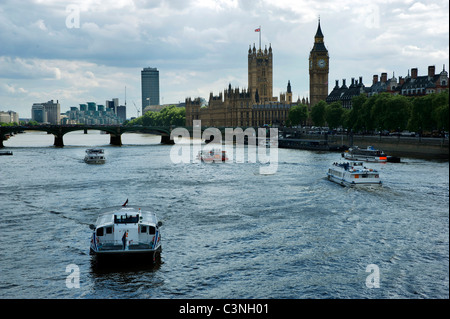 Houses of Parliament, Palace of Westminster, across Thames. London. several several sightseeing boats in foreground. - Stock Photo