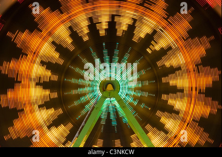Ferris wheel in motion light streaks Evergreen State Fair Monroe Washington State USA - Stock Photo