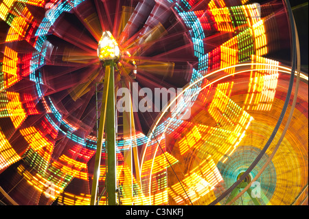 Ferris wheel in motion close up of light streaks Evergreen State Fair Monroe Washington State USA - Stock Photo