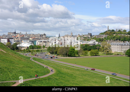 A view of the Edinburgh skyline taken from Holyrood Park. with the Castle at the left and the Palace of Holyroodhouse - Stock Photo