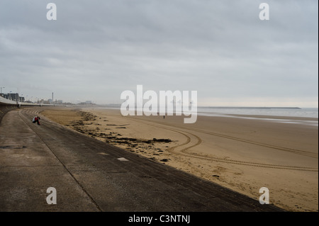 Port Talbot steelworks in the distance as seen from the beach - Stock Photo