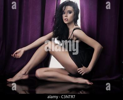 Young female model wearing beautiful dress - Stock Photo