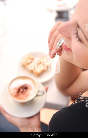 Young woman enjoying coffee time - Stock Photo