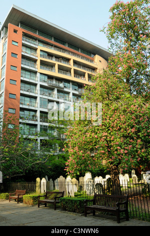 Bunhill Fields burial ground, gravestones with modern flats behind Islington but managed by the City of London England - Stock Photo