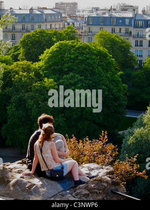 Paris, France, Romantic Young Couple Sitting in Urban Park, Buttes Chaumont, Watching Landscape - Stock Photo
