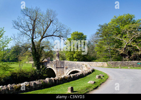 Pretty road bridge and single track road at Iford, Bradford on Avon, Wiltshire, uk taken on fine spring day - Stock Photo