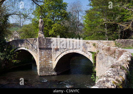 Pretty road bridge over river Frome and single track road at Iford, Bradford on Avon, Wiltshire, uk taken on fine - Stock Photo