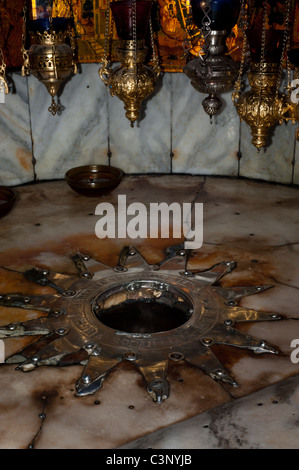 A silver star marks the traditional site of the birth of Jesus in a grotto underneath Bethlehem's Church of the - Stock Photo