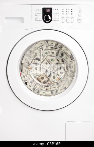 Close up of money in washing machine - Stock Photo