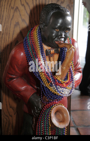 Lakeland Florida Harry's Seafood Bar and & Grille Black musician saxophone statue Mardi Gras beads - Stock Photo