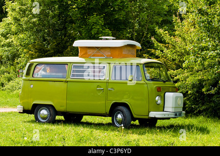 Lime green VW Camper van - parked in a field. UK. - Stock Photo