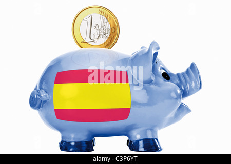 Piggy bank with 1 euro coin and spanish flag - Stock Photo