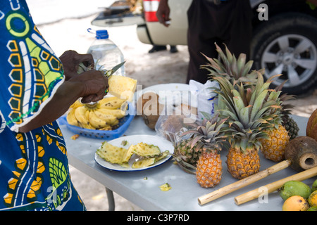 Serving Pineapple sliced on Long Bay Beach in Antigua - Stock Photo