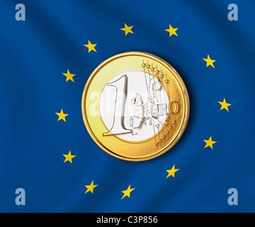 One euro coin against european union flag, close up - Stock Photo