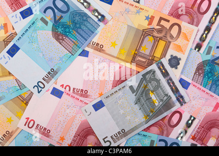 Photo of overlapping Euro banknotes in various denominations. - Stock Photo