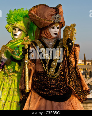 Two costumed revelers in St Mark's square, during Carnival 2011 - Stock Photo