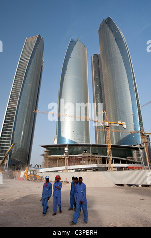 Construction workers at building site of new high rise Etihad Towers in Abu Dhabi United Arab Emirates UAE - Stock Photo