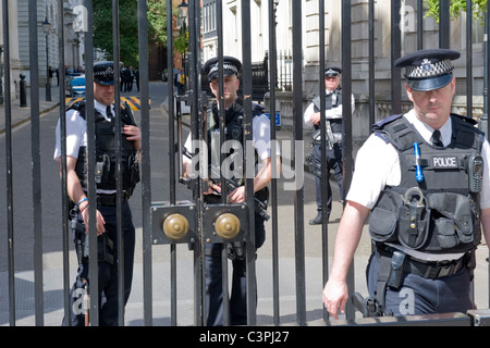 London , Westminster , Whitehall , entrance to Downing Street , armed Metropolitan Police Officers guard security - Stock Photo