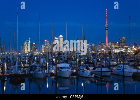 New Zealand, Auckland, North Island, View of boats with city skyline in background - Stock Photo