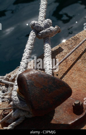 Detail view of bollard with bowline attached - Stock Photo