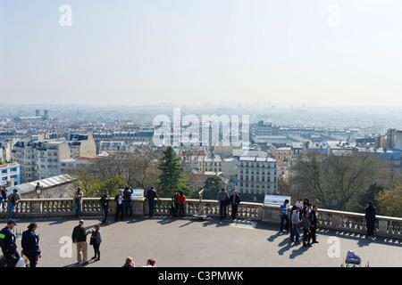 View over the city from the Butte Montmartre by the Basilique du Sacre-Coeur, Montmartre, Paris, France - Stock Photo