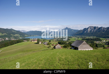 Austria, Salzkammergut, Lake Mondsee with Mount Schafberg in background - Stock Photo