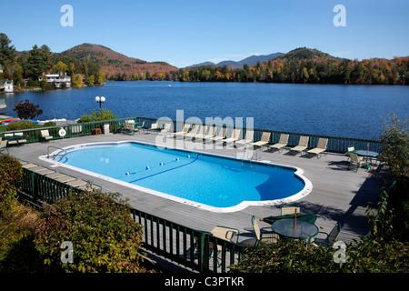 Swimming pool overlooking lake in malcesine on lake garda in northern stock photo royalty free for Hotels in lake garda with swimming pool