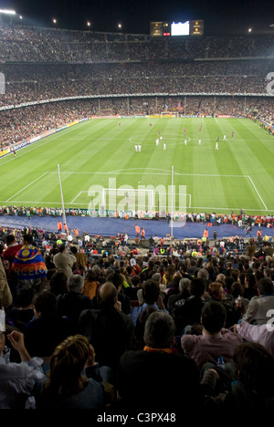 Camp Nou football stadium, home ground to Barcelona Football Club, during a Champions League game. (Spain) - Stock Photo