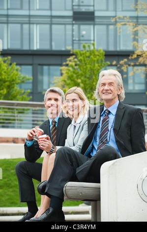 Germany, Hamburg, Business people smiling - Stock Photo