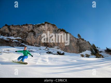 Snowboarder free riding - Stock Photo