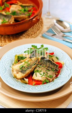 Mackerels with peppers. Recipe available. - Stock Photo