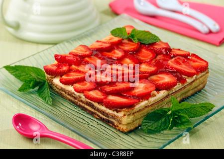 Sponge cake with strawberries. Recipe available. - Stock Photo