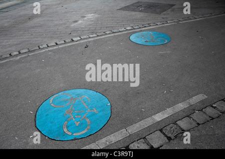 Austria, Vienna, Bicycle lane symbol on road - Stock Photo