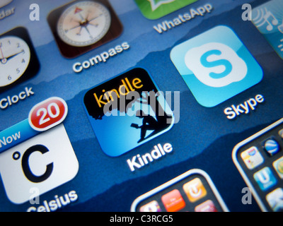 Close-up of screen of iPhone 4G smart phone showing Amazon Kindle ebook app - Stock Photo
