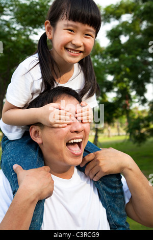 Happy little girl and her father - Stock Photo