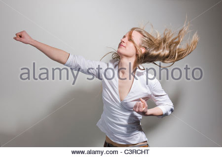 Woman punching in the air - Stock Photo
