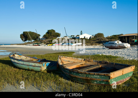 Fishing boats at low tide at Churchhaven in West Coast National Park South Africa - Stock Photo
